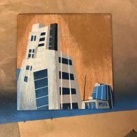 Small spray paint painting of towers in downtown Denver