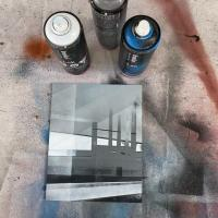 Spray paint on board painting of a factory